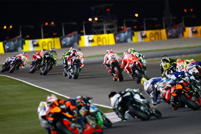 Riders stream through the first turns of the season-opening Qatar grand prix
