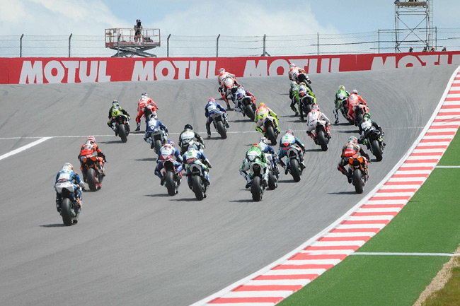 The MotoGP field climbs into turn one at the Circuit of the Americas for the first time. Image: MotoGP.com.